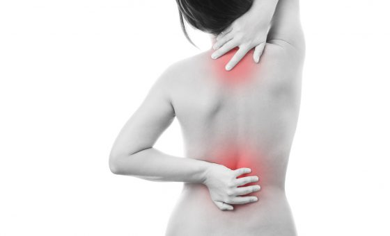 Pain in back of women. Isolated on white background. Caring for the female body. Red dot