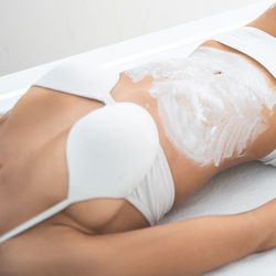 Beauty and health. Young girl in white lingerie having skincare procedure at spa salon